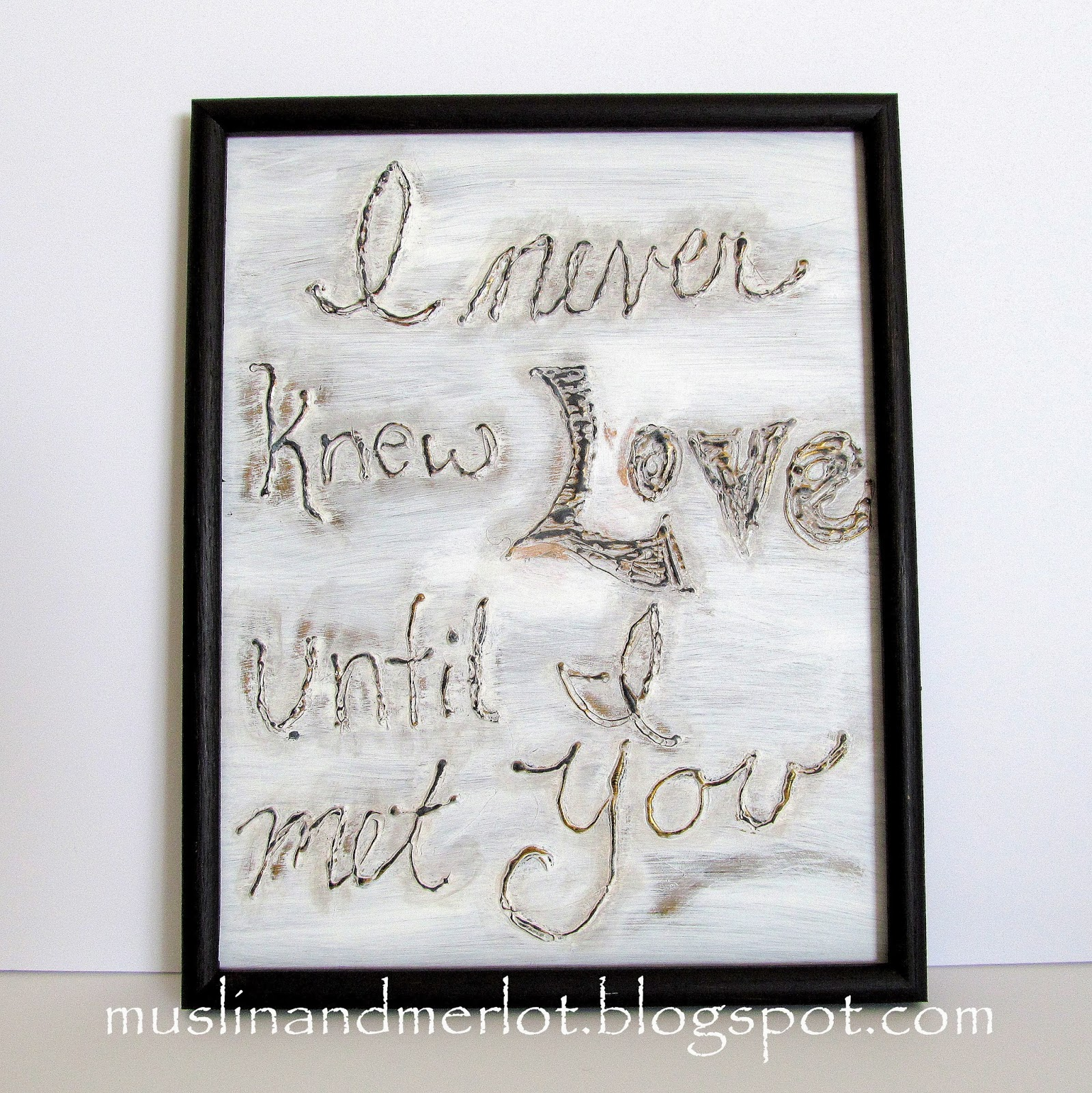 framed glass panel saying I never knew love until i met you, using glue gun and paint