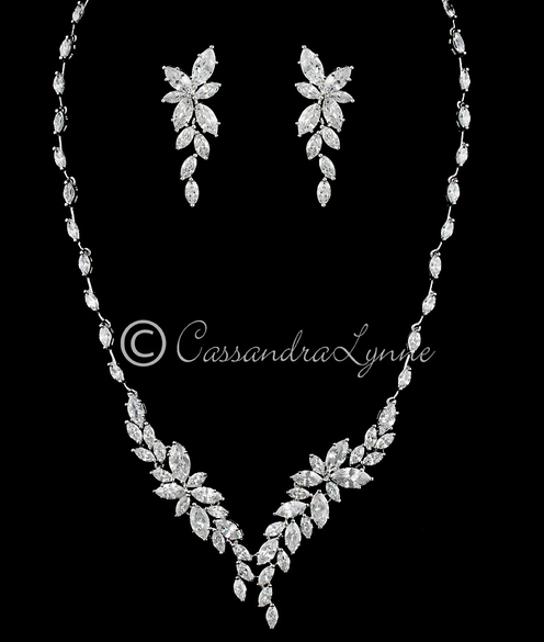 http://cassandralynne.com/collections/wedding-necklace-sets/products/intricate-cz-leaf-bridal-necklace-set