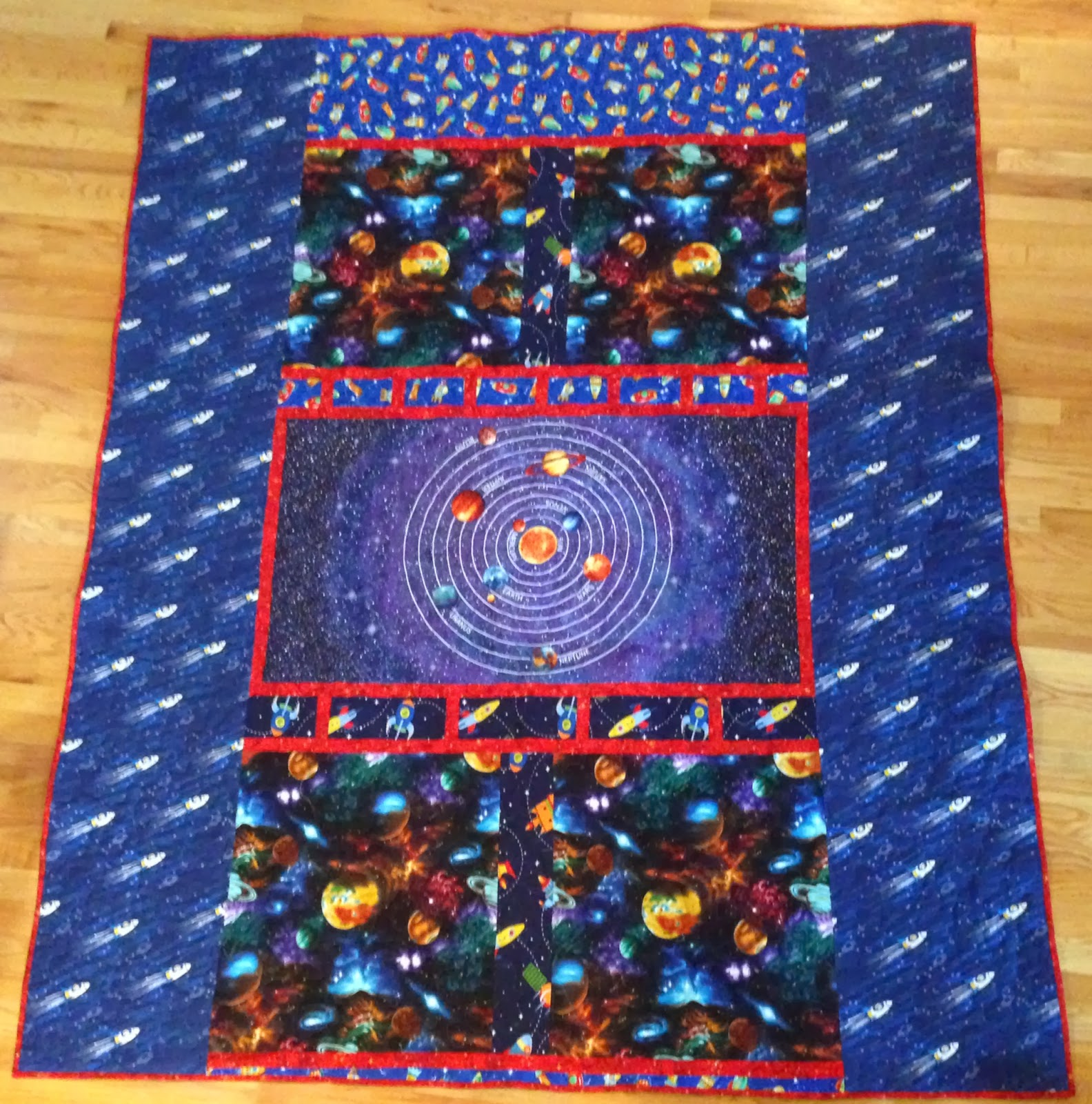 Creative expressions rocket quilt for my grandson for Solar system fabric panel