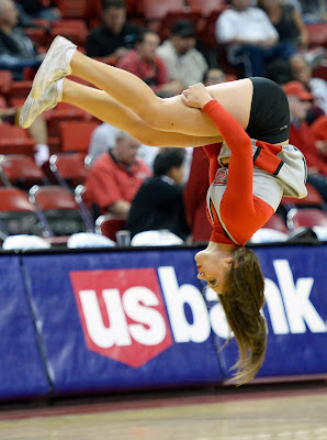 LAS VEGAS, NV - NOVEMBER 12 A UNLV Rebels cheerleader flips through the air during the team's game against the UC Santa Barbara Gauchos at the Thomas & Mack Center on November 12, 2013 in Las Vegas, Nevada. UC Santa Barbara won 86-65