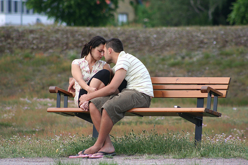 Couples sitting on bench