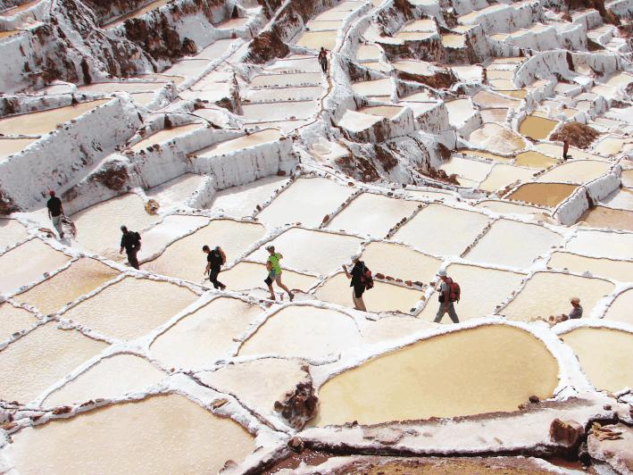 Salt pans built on terraces near Maras, Peru. The pans are fed by ...