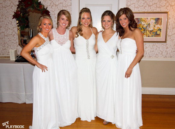 This group of bridesmaids is uniquely wearing white on the big day.