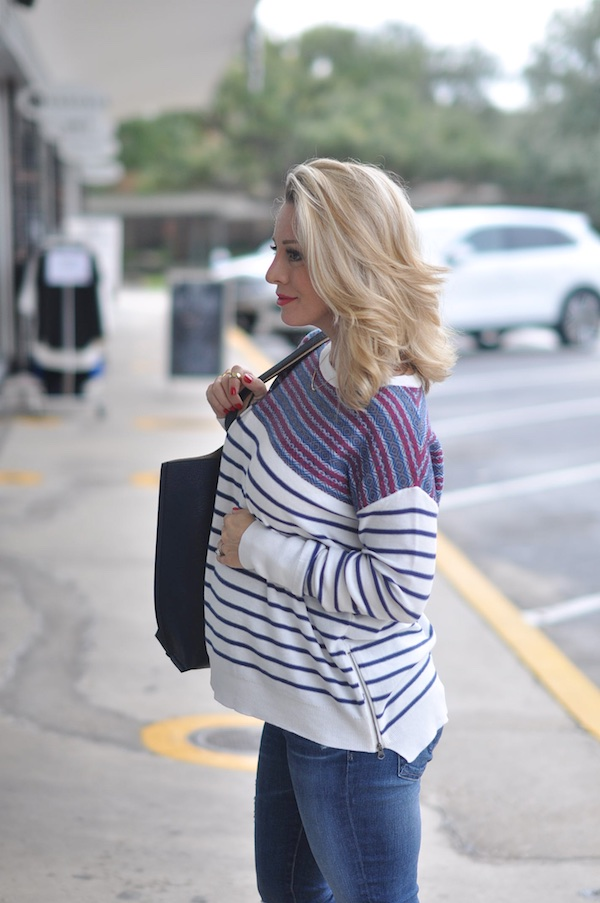 Lightweight striped sweater with zipper accent.
