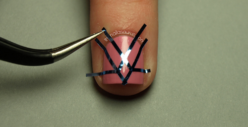Striping tape manicure tutorial the nailasaurus uk nail art blog place the tape in your pattern of choice on your nails and make sure its smoothed down right to the edges or nail polish will seep underneath prinsesfo Image collections