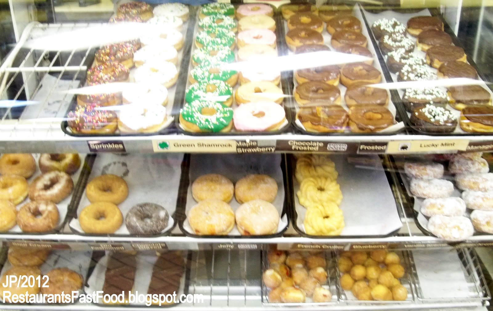 Dunkin Donuts Display Case Doughnut Coffee Glazed Frosted Iced Pastries Panama City Beach Florida