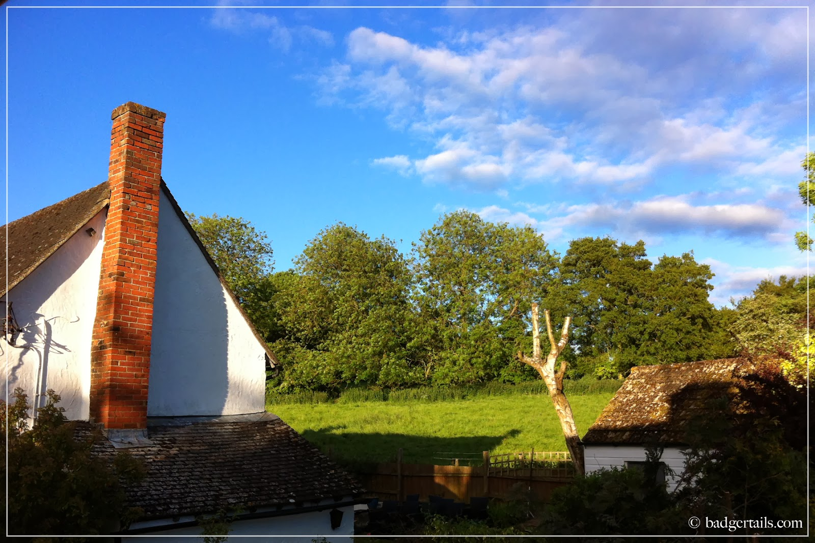 summer in countryside farmhouse view