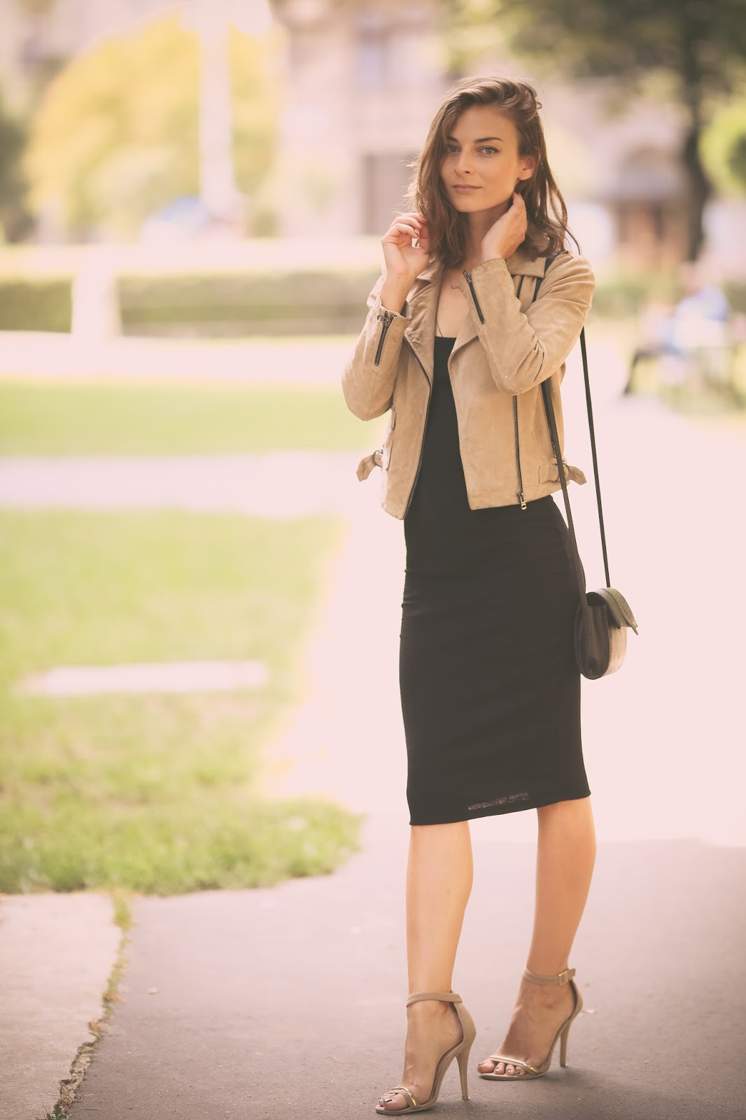 Wearing The Little Black Dress With A Beige Jacket