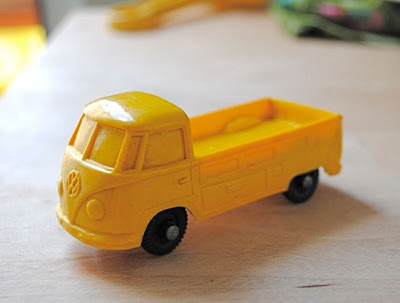 Vintage yellow VW camper toy