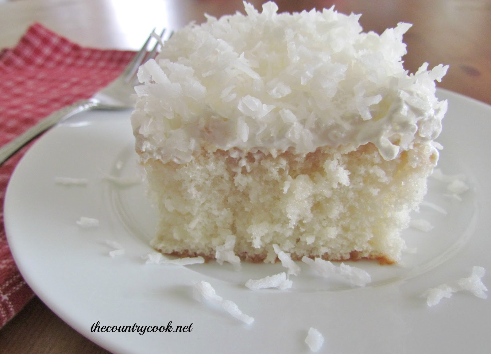 Coconut Cream Poke Cake - The Country Cook