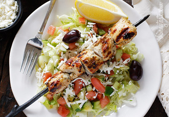 Marinated chunks of grilled chicken breast served over a bed of ...
