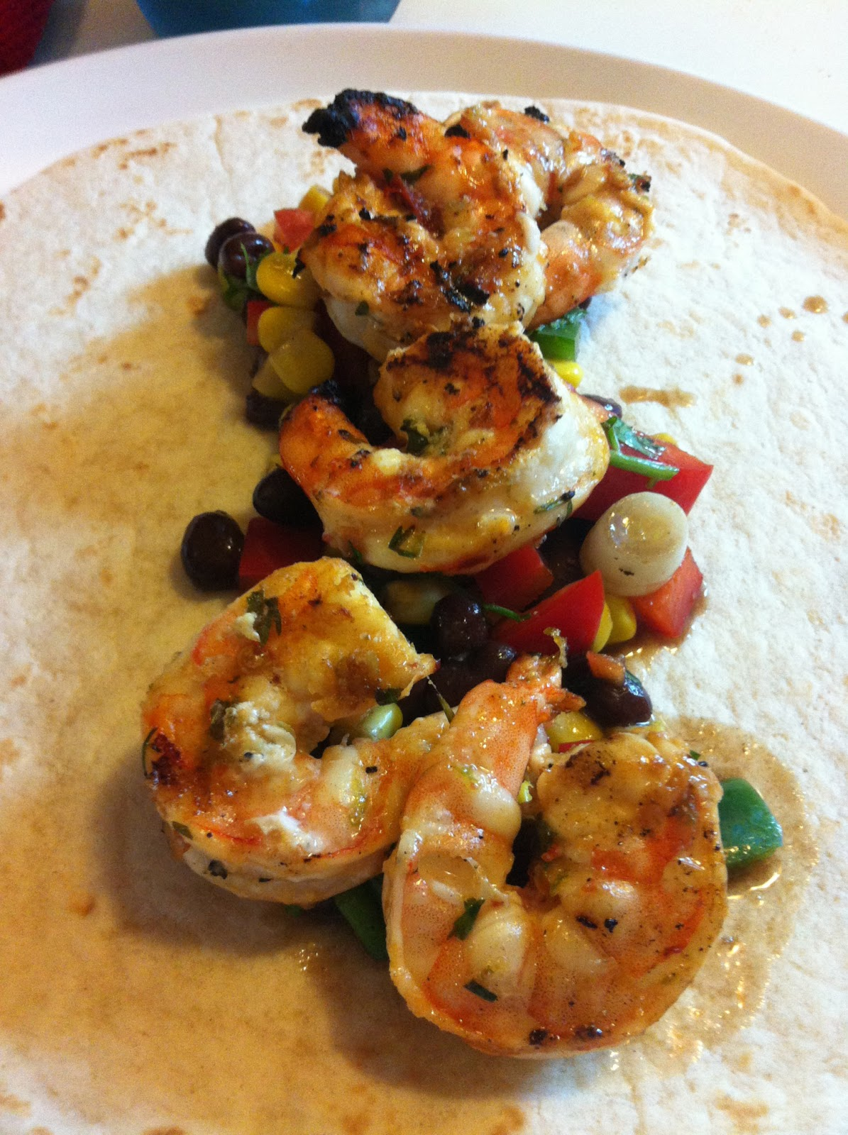Serve shrimp on soft taco shells with black bean and corn salsa .