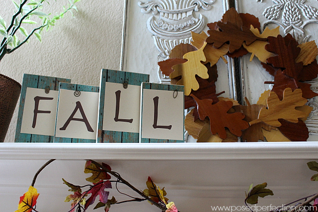 FALL block letters and  wreath of wooden leaves are the stars of this Simple Fall Mantel.