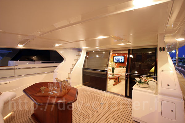 Ferretti 80 at anchor. A large flybridge. A beamy yacht with comfortable ...