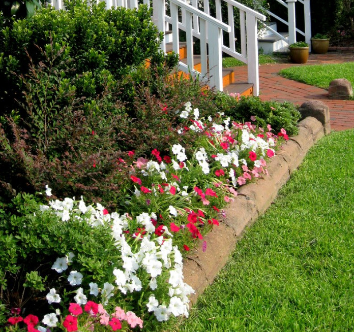 Flower bed designs enrich your garden flower design ideas for Flower bed edging ideas