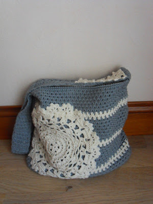 grey crochet bag with a doily