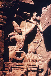 Tripurantaka-Shiva, riding the cosmic chariot and wielding the cosmic bow; stone temple carving, Ellora.