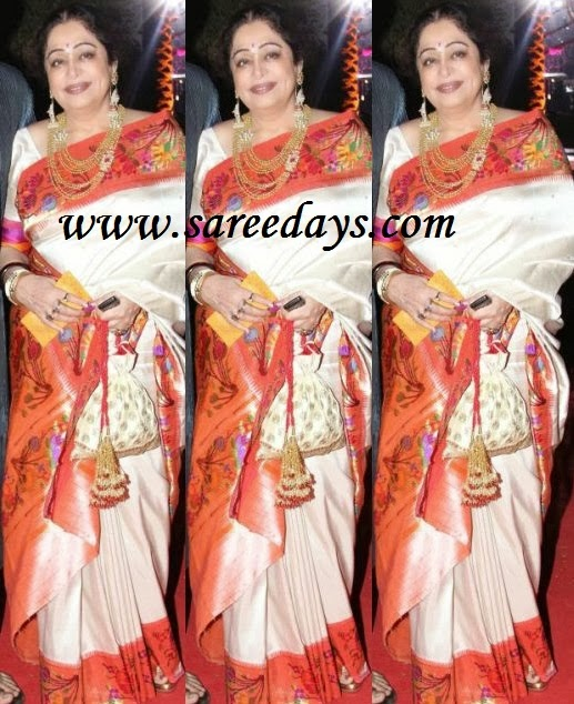 Latest saree designs kirron kher in white kanchipuram silk saree checkout kirron kher in white kanchipuram silk saree with red printed zari work saree and paired with matching half sleeves blouse altavistaventures Image collections