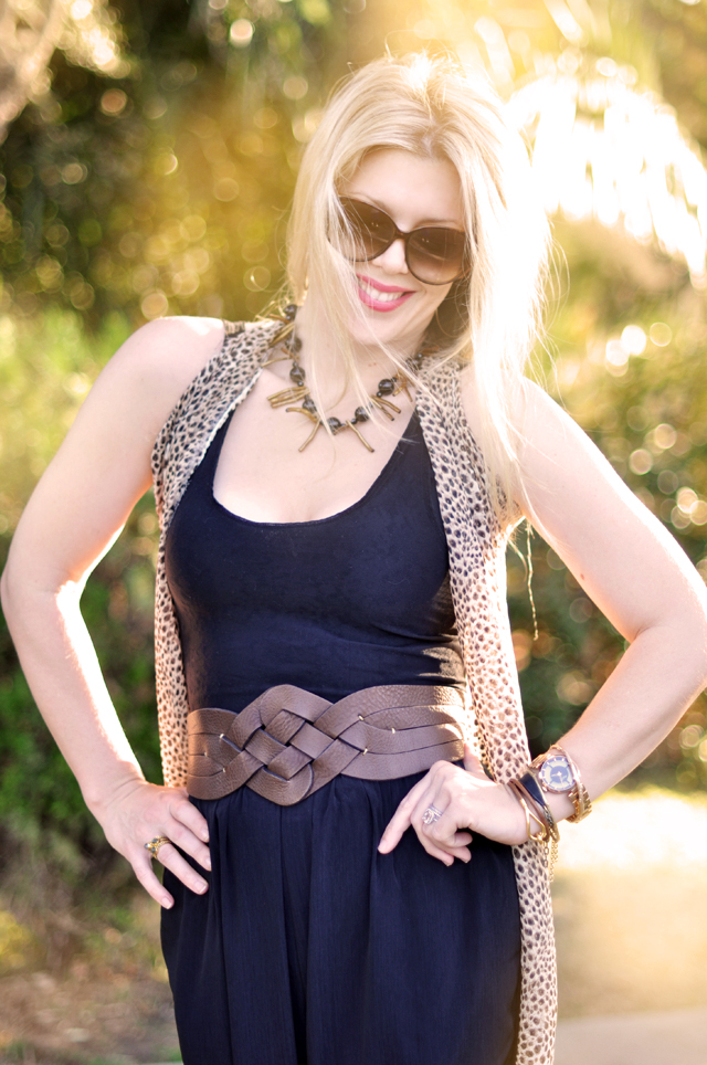 black mock jumpsuit with brown accessories, leopard scarf vest DIY