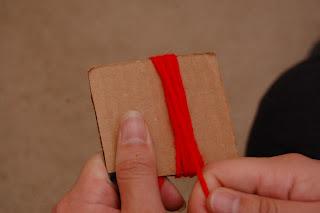 making a pom pom using cardboard