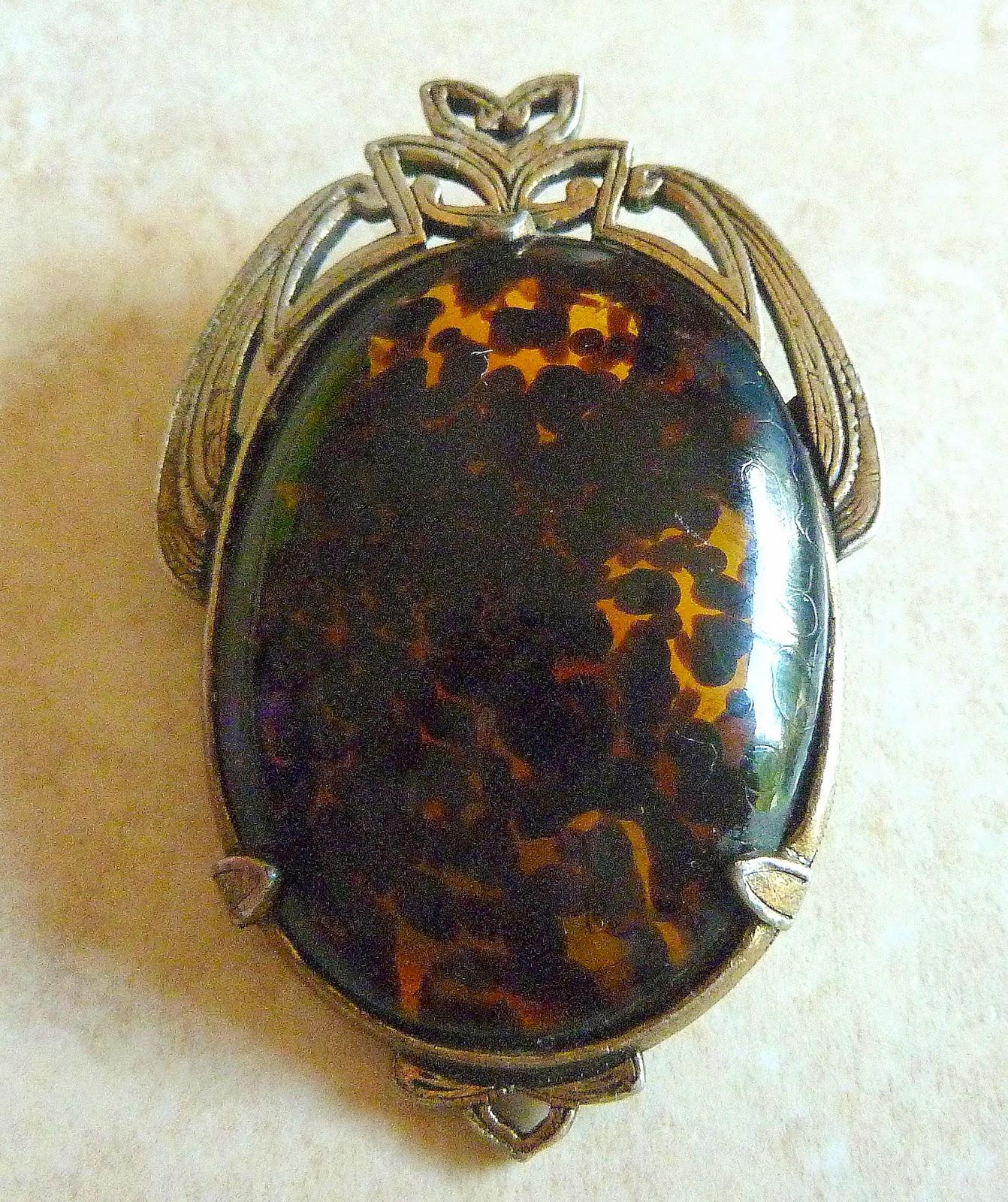 http://www.kcavintagegems.uk/vintage-large-faux-tortoiseshell-art-nouveau-style-brooch-by-miracle-411-p.asp