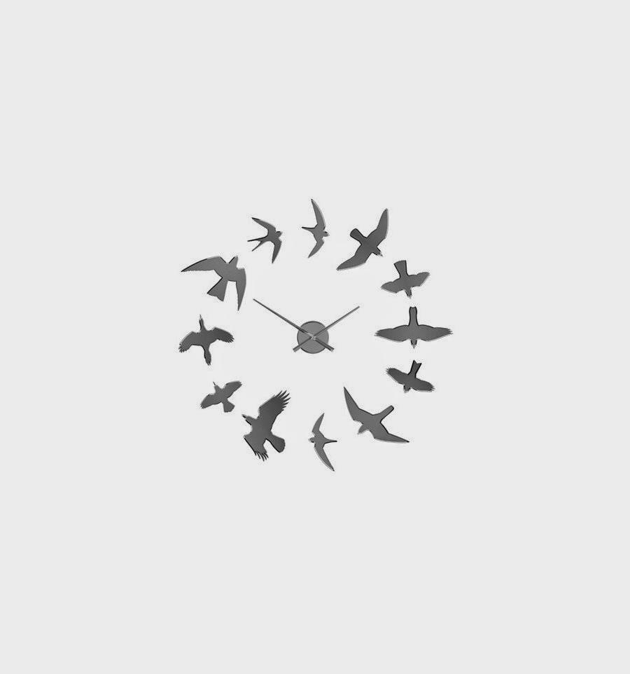 Reloj de pared con pájaros