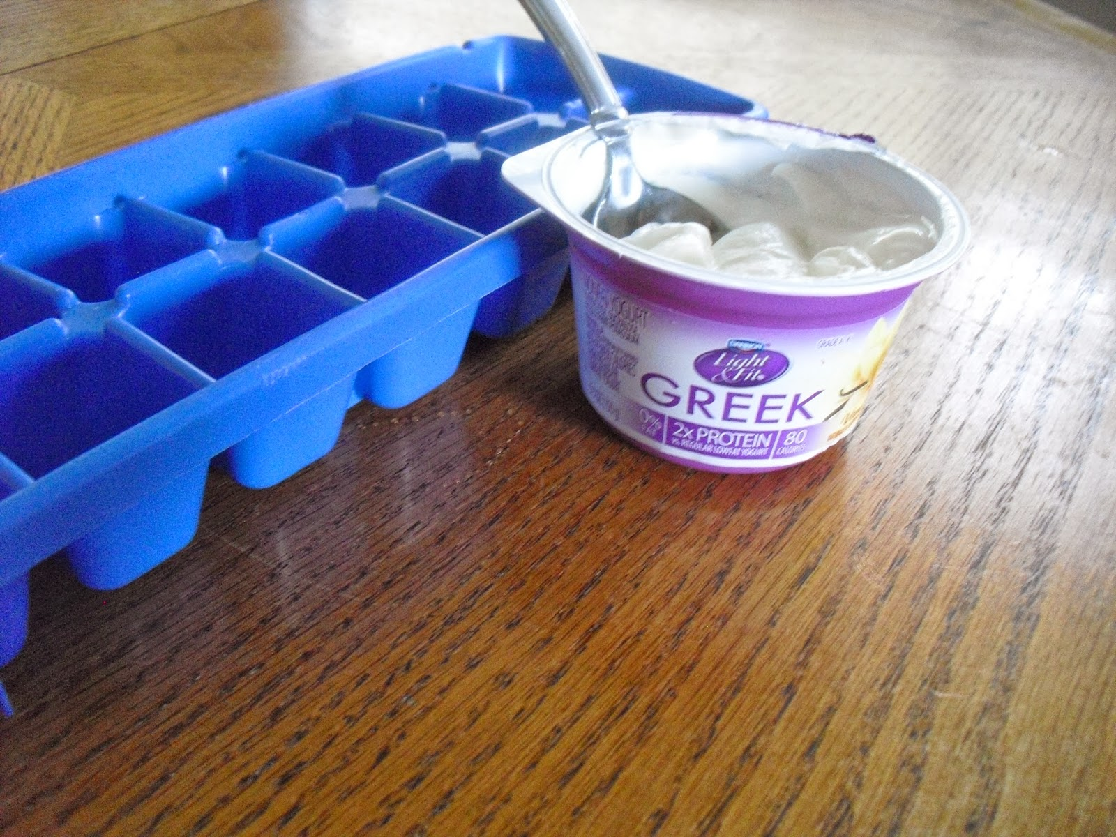 freeze Greek yogurt in ice cube tray
