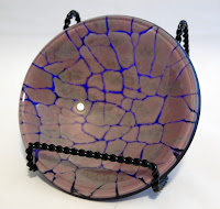 "5"" fused glass crackle bowl. Mauve & pewter powders; blue iridescent glass backing."