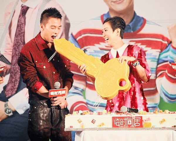 Oho Ou Hao wears Versace Fall Winter 2014 menswear red oiled denim jacket and jeans - Temporary Family Press Conference Hong Kong 17th August 2014