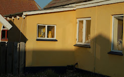 Yellow house with coffee pot
