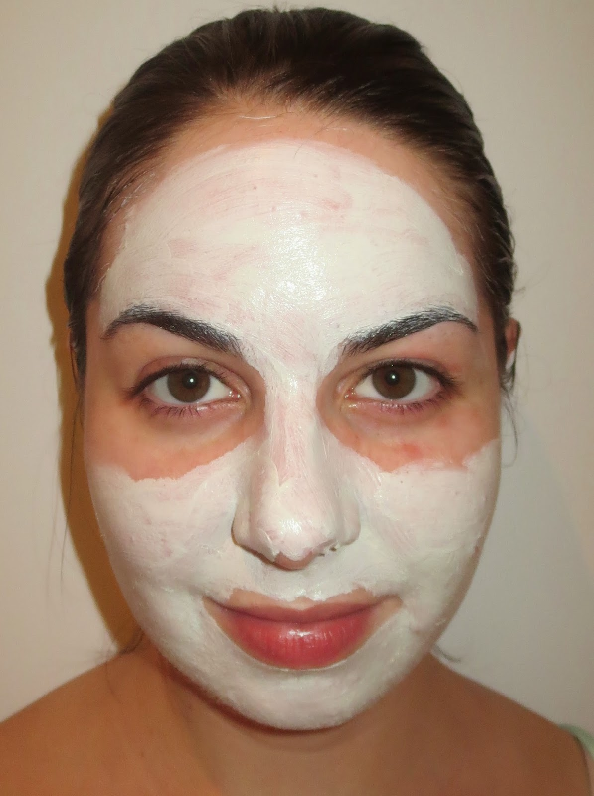 a picture of woman wearing Kiehl's Rare Earth Deep Pore Cleansing Masque