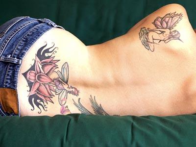 Lower Back Tattoos Designs: Lower back tattoo girl sexy art