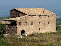 La façana de migdia i l'eixida de La Pinosa