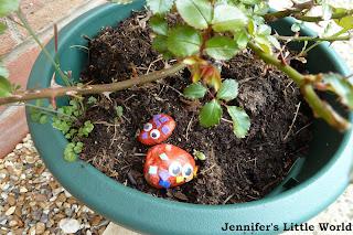 Pebble monsters in flower pot