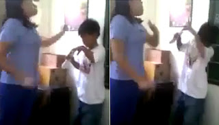 A screenshot from the video where the hand of the woman hits the head of the child.