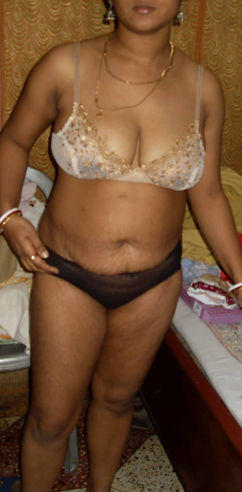 Desi busty aunty posing in different Bra Panty showing huge boobs n ...