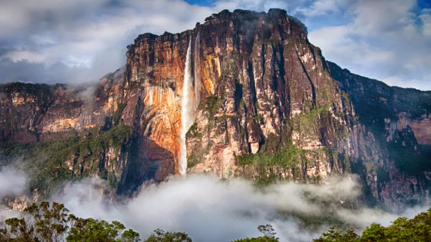 A UNESCO World Heritage site and the highest waterfall on Earth, Angel Falls stands at a breathtaking 3,212 feet tall. The falls are one of Venezuela's biggest tourist attractions, but getting there is no easy feat. Angel Falls is located in a jungle and is only accessible by river from June to December, when the river is deep enough for boat travel.