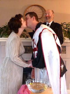 Chris and Morgan kiss to seal their wedding vows - Kent Buttars, Seattle Wedding Officiant