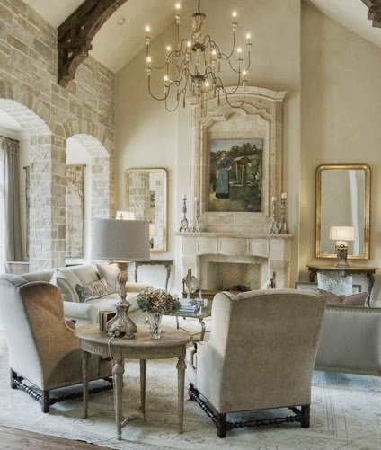 large white living room with gold accents beige neutral furniture stone walls