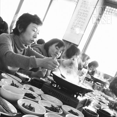 A traditional Korean meal with many side dishes.