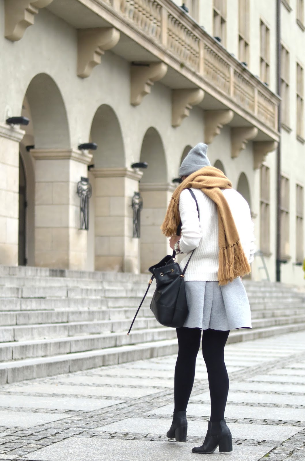 Grey skirt, white sweater, camel oversize scarf ootd