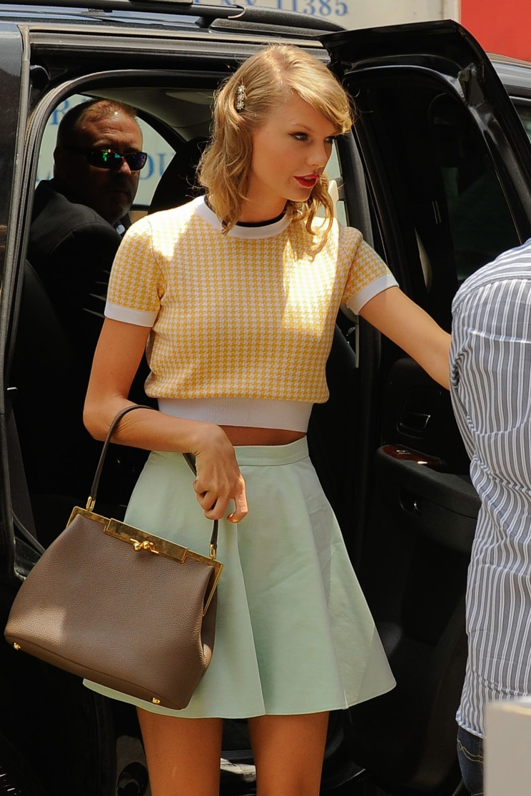 Taylor Swift channels the 50s in a vintage inspired pastel look in NY