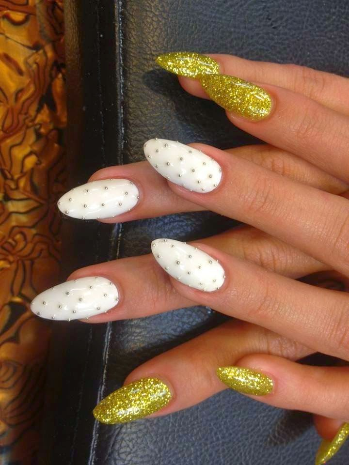 Acrylic almond sculpts + LED polish manicure.. custom mix glitz and the feats are silver studs