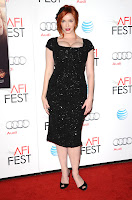 Christina Hendricks in a black dress on the red carpet