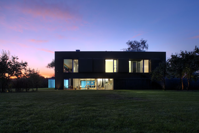 Photo of safest house at sunset with lights turned on