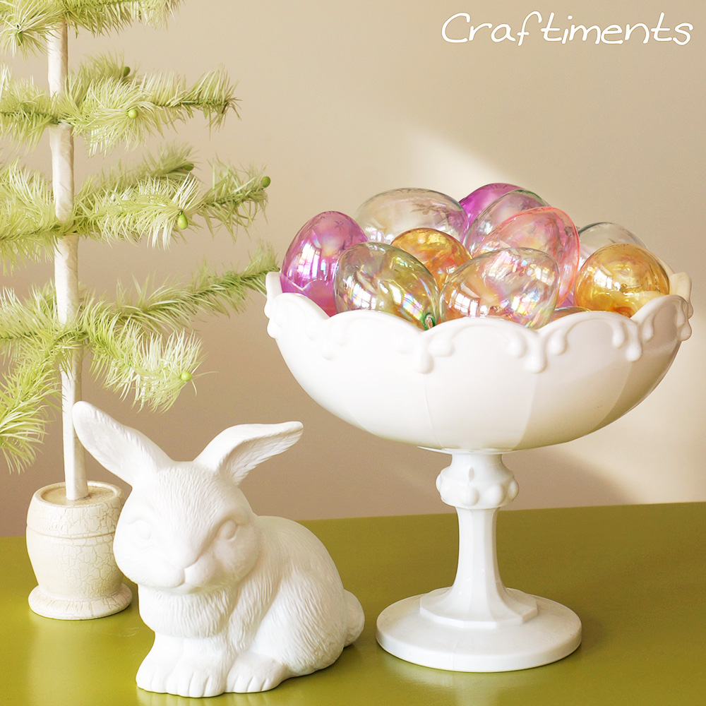 Craftiments easter egg ornaments displayed in a milk
