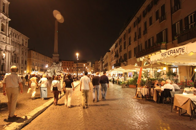 A lot of cafes and restaurants are situated along the sidewalk of Piazza Navona in Rome, Italy