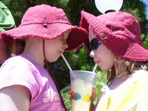 sisters sharing drink