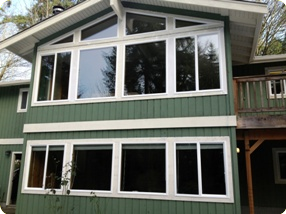 Residential vinyl window replacement seattle bellevue for Best replacement windows for log homes