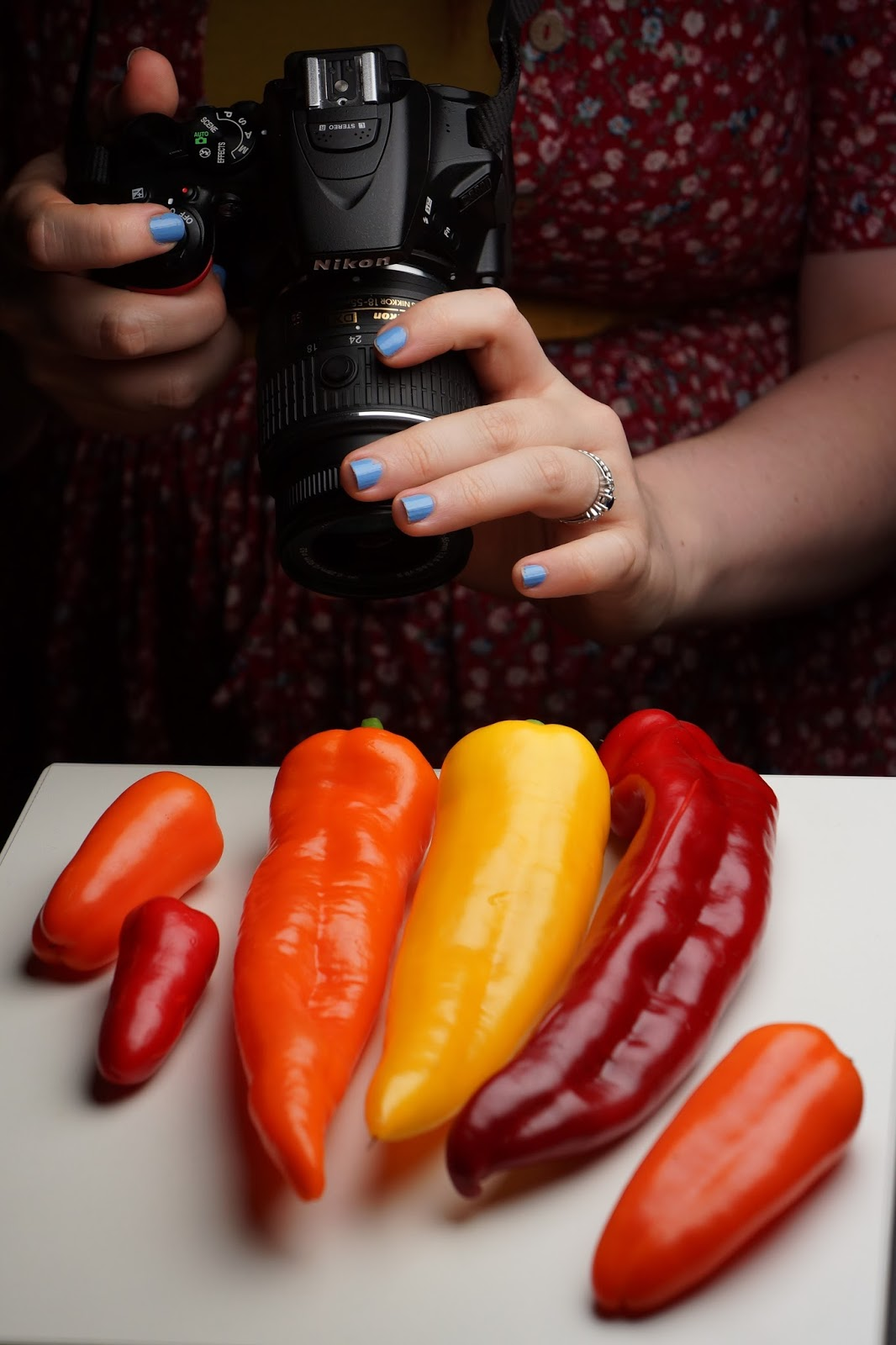 girl taking photographs of food